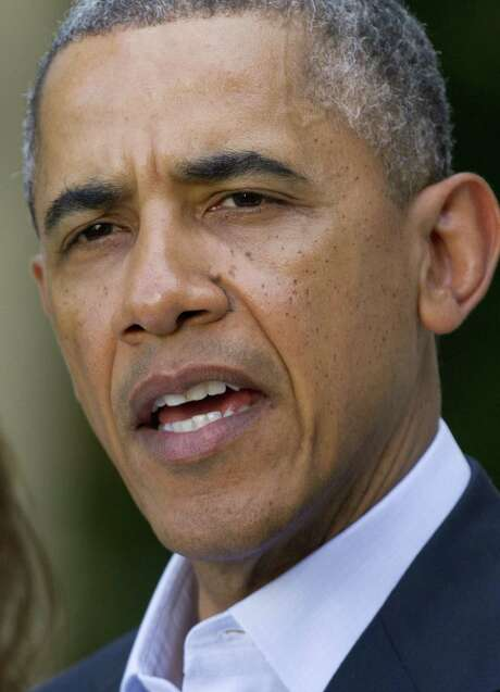 """A French analyst says, """"America may not be best represented by a lawyer with a great intellect."""" / AP"""
