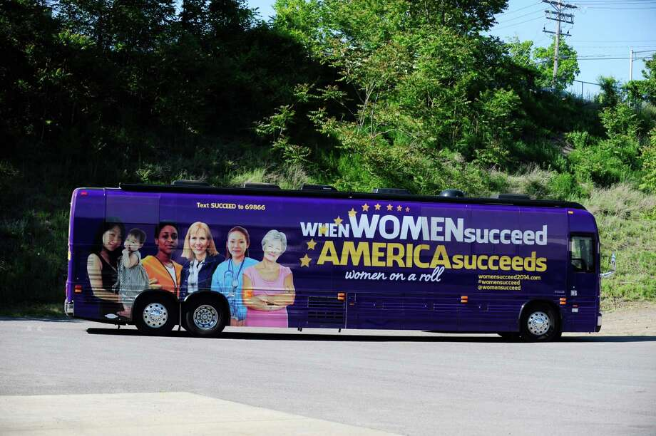 "A bus carrying members of Congress pulls in at the start of a rally at Davies Office Refurbishing on Sunday, June 1, 2014, in Albany, N.Y.  The rally was one of the stops in the ""When Women Succeed, America Succeeds"" Bus Tour.  (Paul Buckowski / Times Union) Photo: Paul Buckowski / 00027129A"