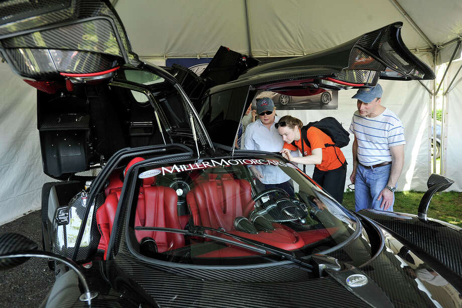 From left: Deborah, Sarah and Mark Reyman, of Armonk, NY, look over a $1.8 million Pagani Huayra sports car during the Greenwich Concours d'Elegance at Roger Sherman Baldwin Park in Greenwich, Conn., on Sunday, June 1, 2014. Photo: Jason Rearick / Stamford Advocate