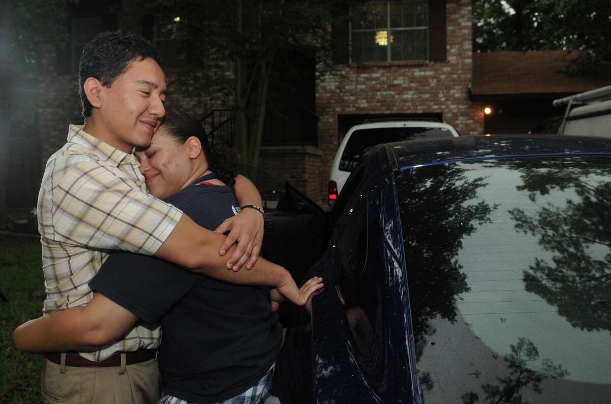 Edgar Torres and girlfriend, Ariana Gibbons, hug in front of his family's home in the Woodlands. He has returned to the U.S. under a credible fear that he might be in danger if he went back to Mexico.