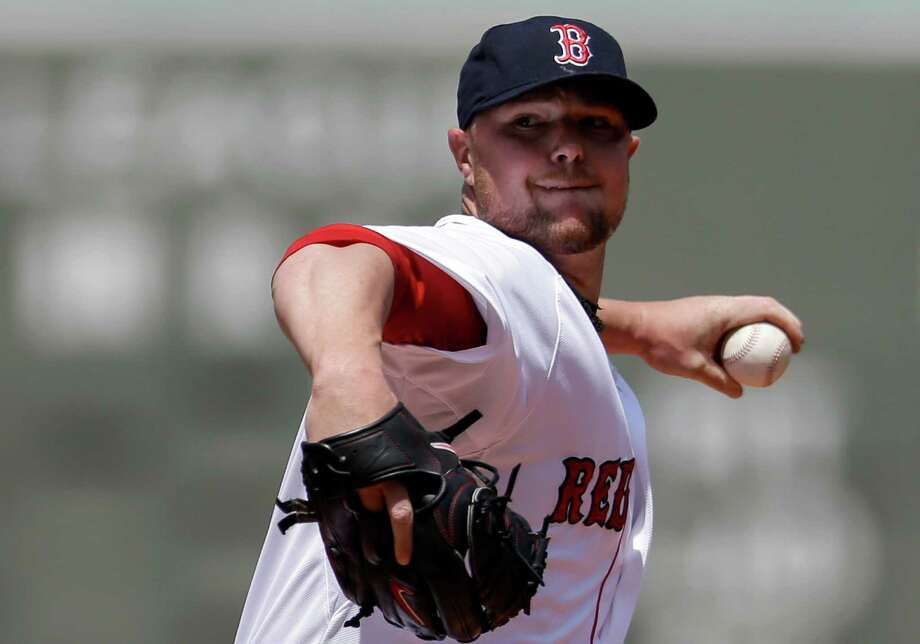 Boston Red Sox's Jon Lester winds up for a pitch against the Tampa Bay Rays in the first inning of a baseball game on Sunday, June 1, 2014, in Boston. (AP Photo/Steven Senne) ORG XMIT: MASR103 Photo: Steven Senne / AP
