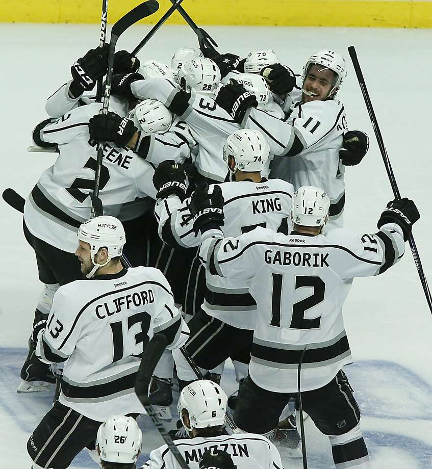 Kings players celebrate after Alec Martinez's overtime goal in Game 7 in Chicago earned them a trip to the Stanley Cup Finals for the second time in three years. They'll face the Rangers. Photo: Robert Gauthier, McClatchy-Tribune News Service