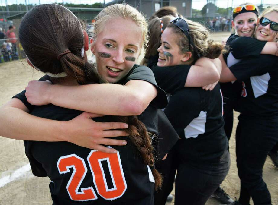 Bethlehem pitcher #9 Emma Downing, gets a hug from team mate #20 Kaitlyn Rarick celebrating their Class AA softball final win against Columbia High Saturday May 31, 2014, in Clifton Park, NY.  (John Carl D'Annibale / Times Union) Photo: John Carl D'Annibale / 00027104A
