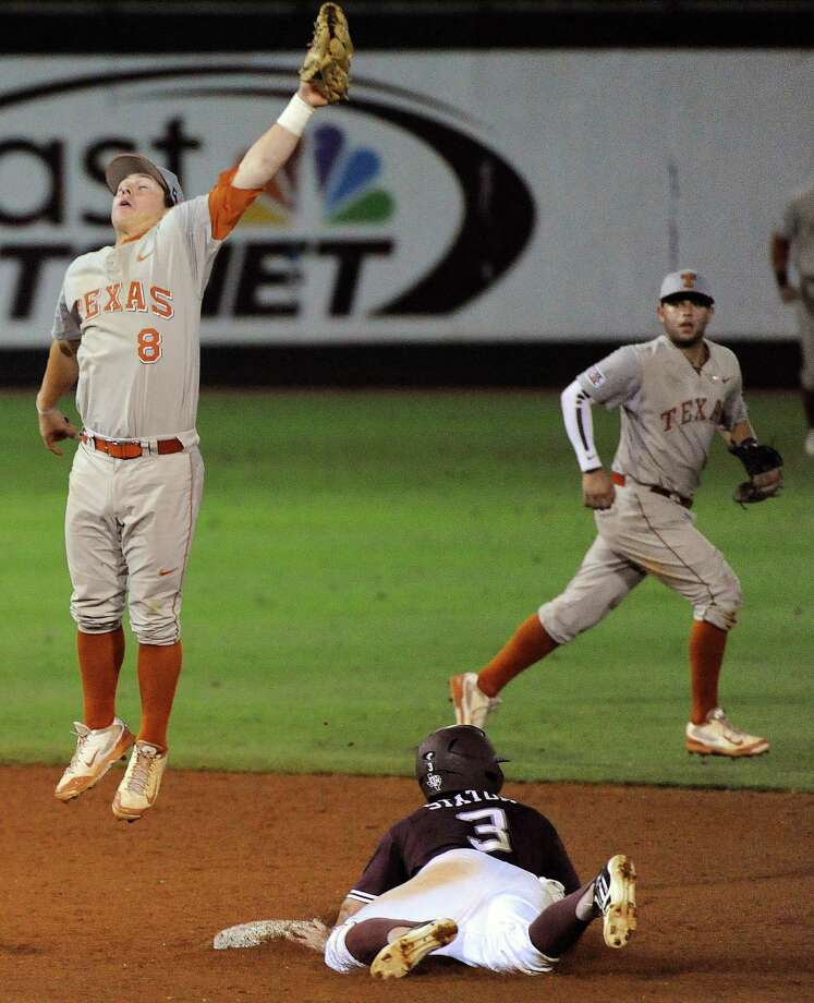Texas A&M's Jace Statum, right, steals second base past Texas' Brooks Marlow (8) during the sixth inning of an NCAA baseball regional game, Sunday, June 1, 2014, at Reckling Park in Houston. Photo: Eric Christian Smith, For The Chronicle