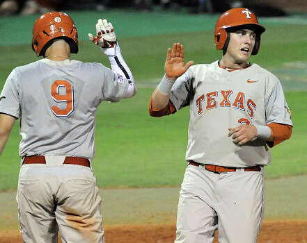 Texas' Mark Payton, right, celebrates his run scored to give Texas the lead, 2-1, during the third inning of an NCAA baseball regional game against Texas A&M, Sunday, June 1, 2014, at Reckling Park in Houston. Photo: Eric Christian Smith, For The Chronicle
