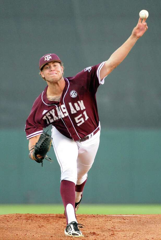 Texas A&M's Tyler Stubblefield delivers a pitch during the first inning of an NCAA baseball regional game against Texas, Sunday, June 1, 2014, at Reckling Park in Houston. Photo: Eric Christian Smith, For The Chronicle