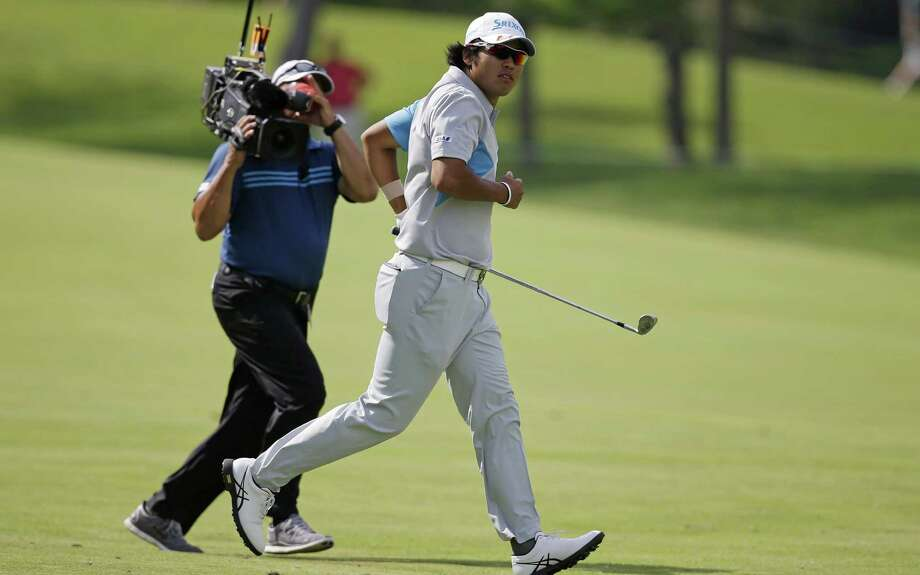 Hideki Matsuyama sprints to see his shot on No. 18 during the final round of the Memorial. Matsuyama won in a playoff. Photo: Darron Cummings / Associated Press / AP