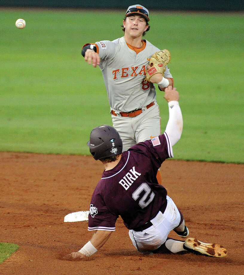 Texas second baseman Brooks Marlow, top, throws to first in a double play attempt past Texas A&M's Ryne Birk during the first inning of an NCAA baseball regional game, Sunday, June 1, 2014, at Reckling Park in Houston. Photo: Eric Christian Smith, For The Chronicle