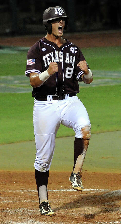 Texas A&M's Logan Nottebrook celebrates his run scored to tie the game 1-1, during the second inning of an NCAA baseball regional game against Texas, Sunday, June 1, 2014, at Reckling Park in Houston. Photo: Eric Christian Smith, For The Chronicle
