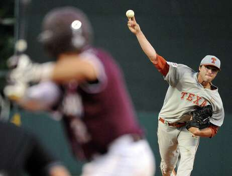 Texas' Lukas Schiraldi delivers a pitch during the first inning of an NCAA baseball regional game against Texas A&M, Sunday, June 1, 2014, at Reckling Park in Houston.   (AP Photo/Houston Chronicle, Eric Christian Smith) Photo: Eric Christian Smith, Associated Press / Houston Chronicle
