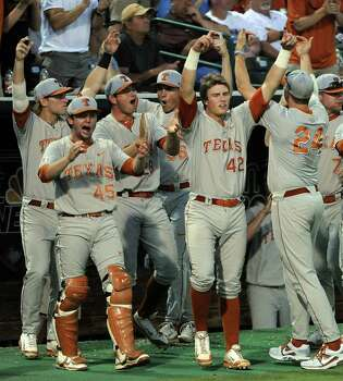 Texas' Kacy Clemens (42) and the Longhorns' dugout celebrate the Longhorns' first score of the game during the first inning of an NCAA baseball regional game against Texas A&M, Sunday, June 1, 2014, at Reckling Park in Houston.   (AP Photo/Houston Chronicle, Eric Christian Smith) Photo: Eric Christian Smith, Associated Press / Houston Chronicle