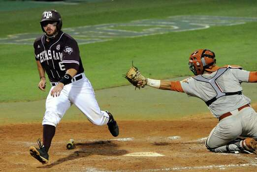 Texas A&M's Troy Stein, left, scores a run past Texas catcher Tres Barrera during the fourth inning of an NCAA baseball regional game, Sunday, June 1, 2014, at Reckling Park in Houston.  (AP Photo/Houston Chronicle,  Eric Christian Smith) Photo: Eric Christian Smith, Associated Press / Houston Chronicle