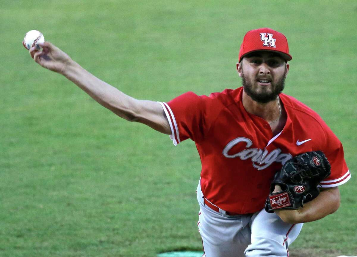 Houston pitcher David Longville pitches in the first inning of an NCAA college baseball regional tournament game against LSU in Baton Rouge, La., Sunday, June 1, 2014. Houston won 9-5. (AP Photo/Gerald Herbert)