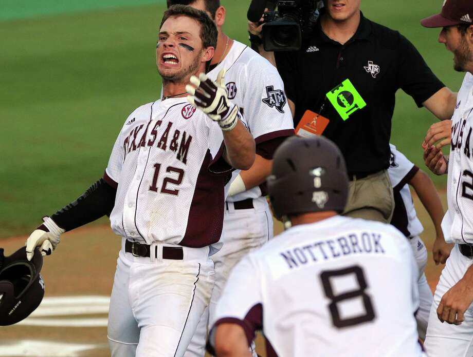 "Texas A&M's Cole Lankford (12) celebrates his grand slam in the seventh inning of the Aggies' win over Rice. ""Our guys showed incredible toughness,"" A&M assistant Justin Seely said. Photo: Eric Christian Smith / For The Houston Chronicle"