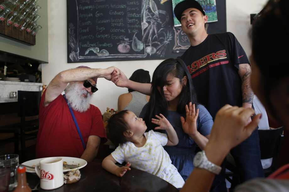 Visually impaired for the past 8 years, Noeleke Glenn Klavert enjoys time with his new tribe of friends, Benson Ng, Maya Tan, 18-months, Ixchel Acosta and Joyce Lee (rt) at Eats in San Francisco, Calif. Photo: Mike Kepka , The Chronicle