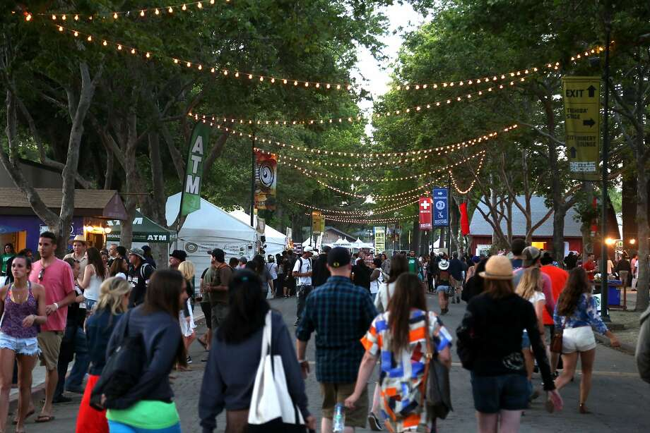Crowds walk along Main Street at the Napa Valley Expo during the final evening of the 2014 Bottlerock Napa Valley music, food and wine festival on Sunday, June 1, 2014 in Napa, Calif. Photo: Kevin N. Hume, The Chronicle
