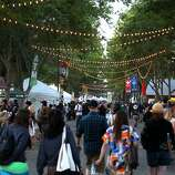 Crowds walk along Main Street at the Napa Valley Expo during the final evening of the 2014 Bottlerock Napa Valley music, food and wine festival on Sunday, June 1, 2014 in Napa, Calif.