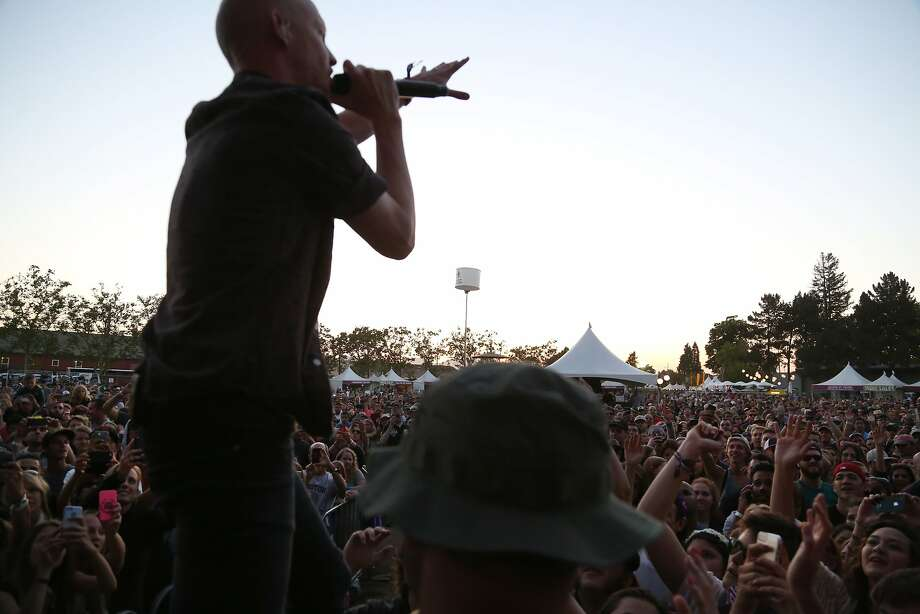 Isaac Slade sings to the crowd while standing on top of a barricade as a security guard watches him closely at the 2014 Bottlerock Napa Valley music, food and wine festival on Sunday, June 1, 2014 in Napa, Calif. Photo: Kevin N. Hume, The Chronicle