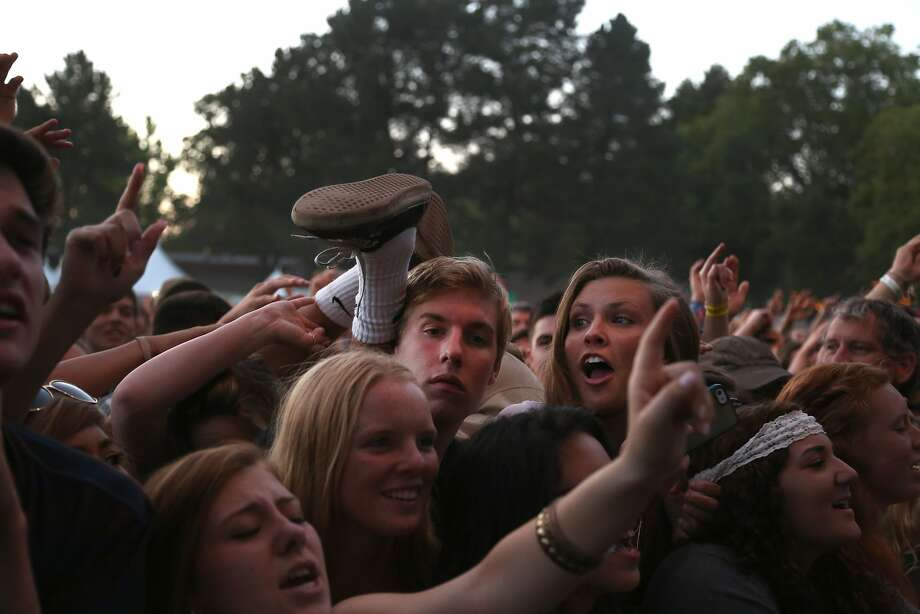 A fan gets hit in the head by a crowd surfer's ankle during The Fray's set at the 2014 Bottlerock Napa Valley music, food and wine festival on Sunday, June 1, 2014 in Napa, Calif. Photo: Kevin N. Hume, The Chronicle