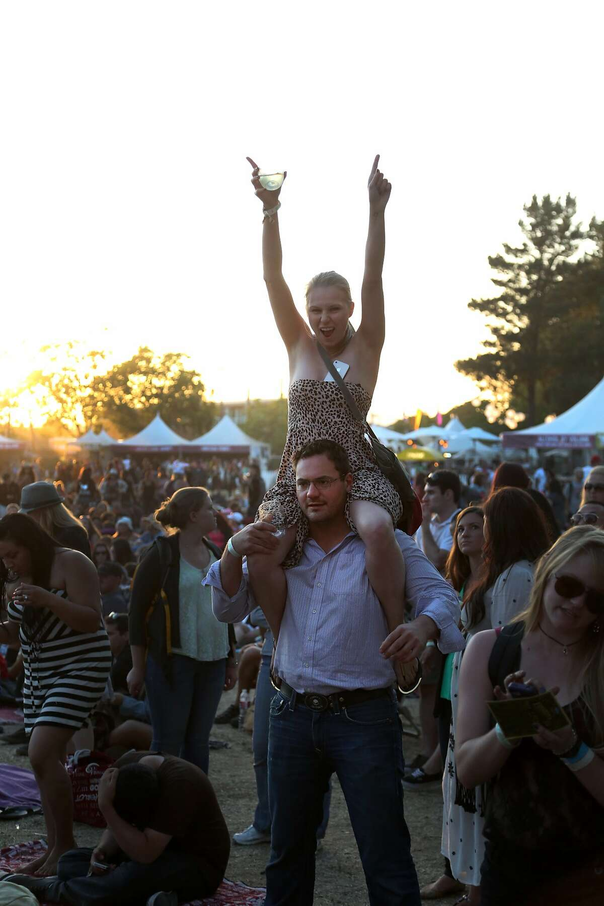 Bryan Hollingsworth of Orange County holds a cheering Meagan Nelson of Novato on his shoulders before The Fray performs at the 2014 Bottlerock Napa Valley music, food and wine festival on Sunday, June 1, 2014 in Napa, Calif.