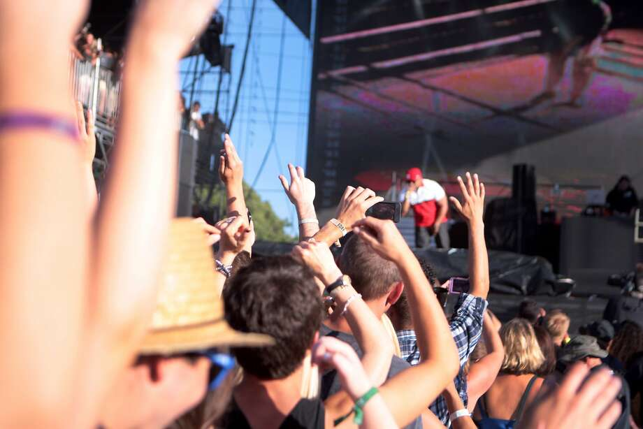 Fans wave their hands in the air as LL Cool J performs at the 2014 Bottlerock Napa Valley music, food and wine festival on Sunday, June 1, 2014 in Napa, Calif. Photo: Kevin N. Hume, The Chronicle