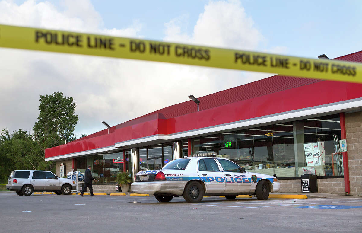 Police investigate the scene of a shooting at a Phillips 66 convenience store in the 15600 block of Eastex Freeway, Monday, June 2, 2014, in Houston. Three to four gunmen reportedly killed a gas station clerk during a robbery about 11:45 p.m. Sunday at the store near Greens Road. Houston police are investigating.