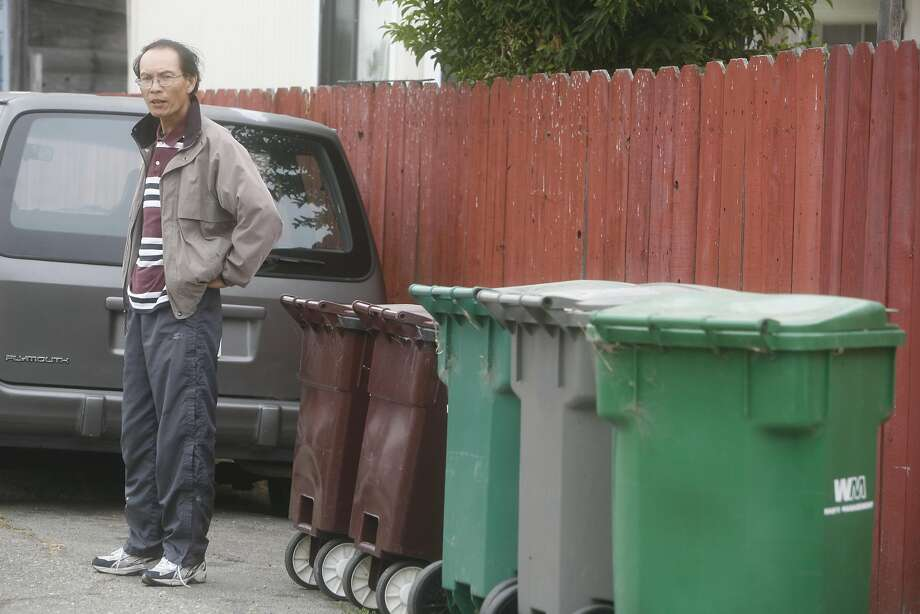 In this 2007 file photo, Jimmy Chiu, who owned the building he lives in on Commerce and 20th Avenue in Oakland since 1989 did not have his  trash picked up in weeks during a labor disputer at Oakland's trash collector Waste Management. Photo: Mike Kepka, SFC