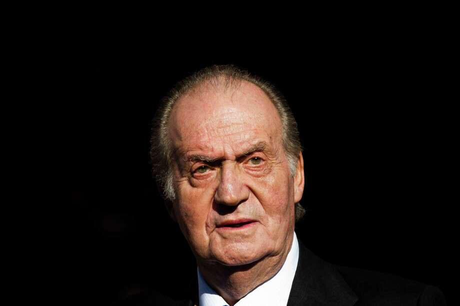 FILE - In this Tuesday, Dec. 27, 2011, file photo Spain's King Juan Carlos leaves after the official opening of the Parliament, in Madrid. Spain's King Juan Carlos plans to abdicate and pave the way for his son, Crown Prince Felipe, to take over, Spanish Prime Minister Mariano Rajoy told the country Monday in an announcement broadcast nationwide. The 76-year-old Juan Carlos oversaw his country's transition from dictatorship to democracy but has had repeated health problems in recent years. Photo: Daniel Ochoa De Olza, ASSOCIATED PRESS / AP