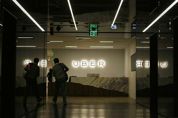 An employee walks into Uber's new office on Market St. in San Francisco, Calif. on Friday, May 30, 2014. This is Uber's seventh move.