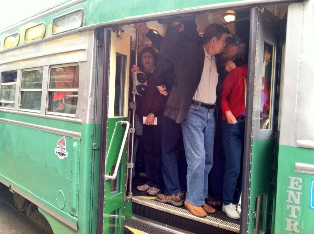 A MUNI streetcar at 5th and Market Streets is packed with riders on Monday morning.