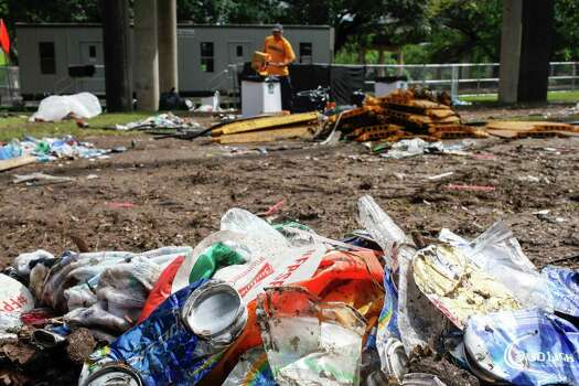 Clean up and breakdown occurs, June 2, 2014 in Houston in Eleanor Tinsley park following a weekend concert, Free Press Summer Fest. Photo: Eric Kayne, For The Chronicle / Eric Kayne