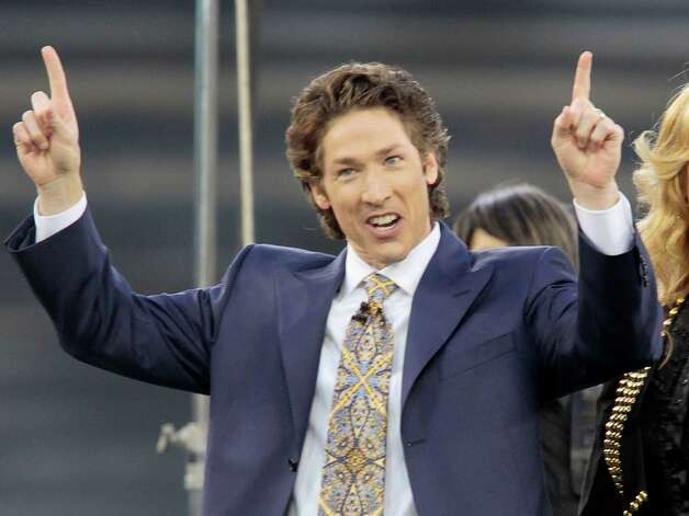 "FILE - This April 24, 2010 file photo shows Lakewood Church pastor Joel Osteen at Dodger Stadium during his ""A Night of Hope"" in Los Angeles. Osteen is getting his own channel on SiriusXM satellite radio, which will air his sermon at Yankee Stadium this Saturday, June 7, 2014.See how Osteen's Lakewood Church has grown in the past 50 years into one of the world's largest ministries ...  Photo: Richard Vogel, AP / AP"