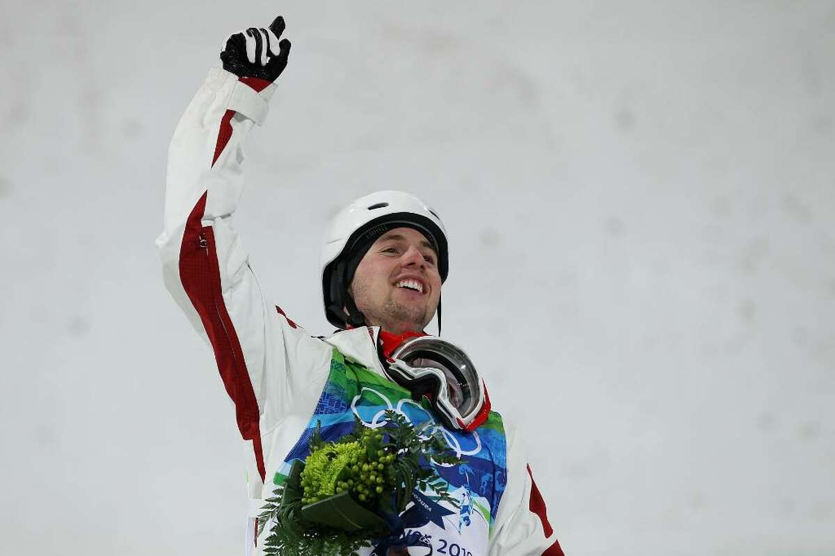 VANCOUVER, BC - FEBRUARY 14: Alexandre Bilodeau of Canada celebrates winning the gold medal during the flower ceremony for the Freestyle Skiing Men's Moguls on day 3 of the 2010 Winter Olympics at Cypress Freestyle Skiing Stadium on February 14, 2010 in Vancouver, Canada. Alexandre Bilodeau of Canada becomes the first Canadian to win a gold medal on home soil at the Winter Olympic Games. (Photo by Jamie Squire/Getty Images) *** Local Caption *** Alexandre Bilodeau