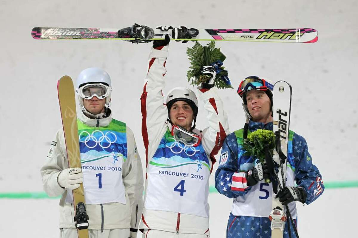 VANCOUVER, BC - FEBRUARY 14: (L-R) Dale Begg-Smith of Australia celebrates winning silver, Alexandre Bilodeau of Canada gold and Bryon Wilson of United States bronze during the flower ceremony for the Freestyle Skiing Men's Moguls on day 3 of the 2010 Winter Olympics at Cypress Freestyle Skiing Stadium on February 14, 2010 in Vancouver, Canada. Alexandre Bilodeau of Canada becomes the first Canadian to win a gold medal on home soil at the Winter Olympic Games. (Photo by Jamie Squire/Getty Images) *** Local Caption *** Dale Begg-Smith;Alexandre Bilodeau;Bryon Wilson