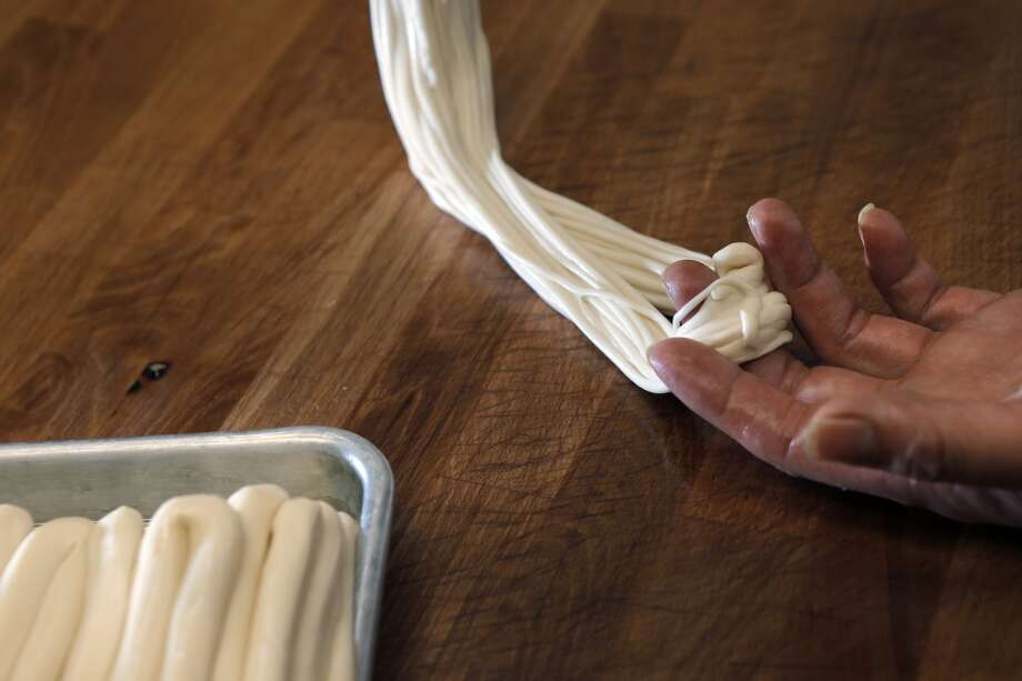 The Biang Biang noodles being pulled and folded into smaller noodles and boiled to be served at the Terra Cotta Warrior in San Francisco, Calif., on Wednesday, May 28, 2014. Photo: The Chronicle