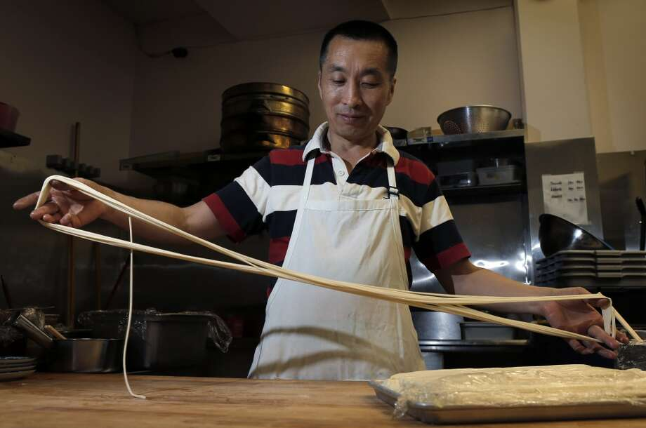 The Biang Biang noodles being pulled and folded into smaller noodles by Lin Zhao to be served at the Terra Cotta Warrior in San Francisco, Calif., on Wednesday, May 28, 2014. Photo: The Chronicle