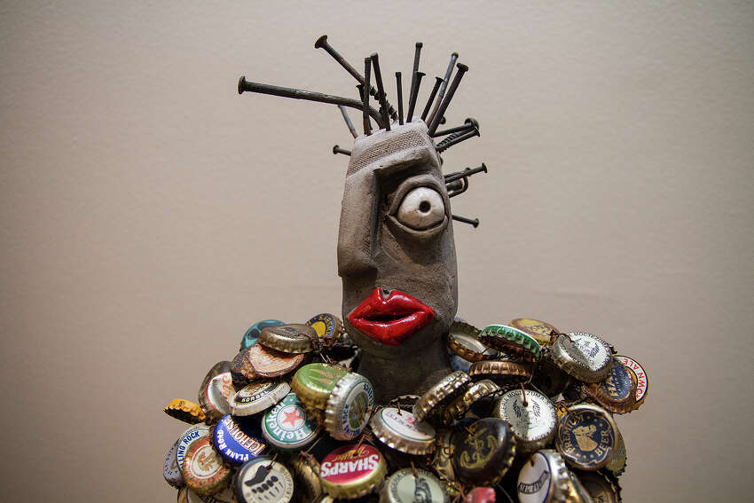 A piece by Billy Ray and Beverly Mangham in the home of Linda Billa Burke is made from beer caps and chicken wire.