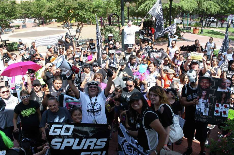 Spurs fans march through downtown Sunday to support the Best in the West. Photo: Libby Castillo