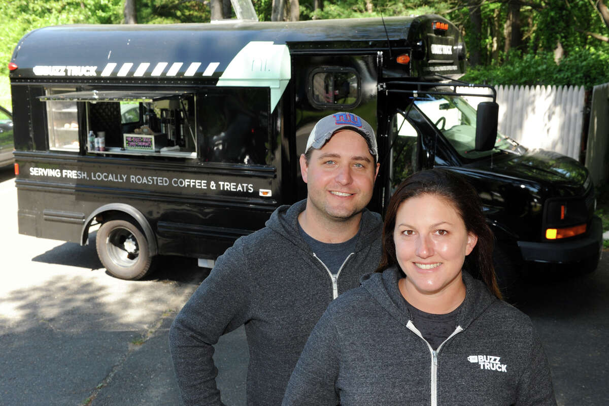 Alex and Jessica Grutkowski, owners of The Buzz Truck, a converted school bus that sells coffee and other items, seen here at the Earthplace Nature Center, in Westport, Conn. May 29, 2014.