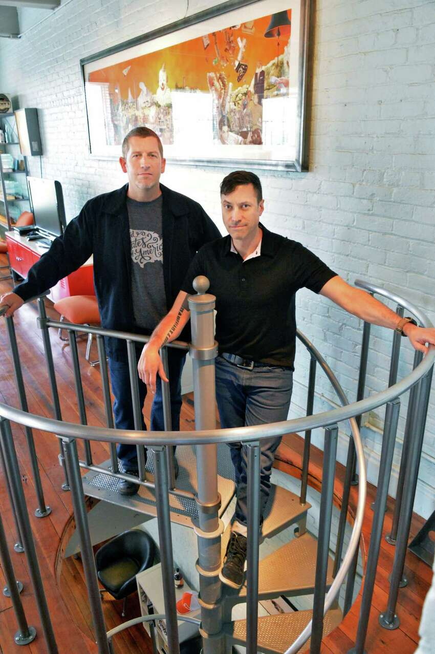 id29 design studio principals Doug Bartow, left, and Michael Fallone in their offices above Revolution Hall on River Street Wednesday May 14, 2014, in Troy, NY. (John Carl D'Annibale / Times Union)
