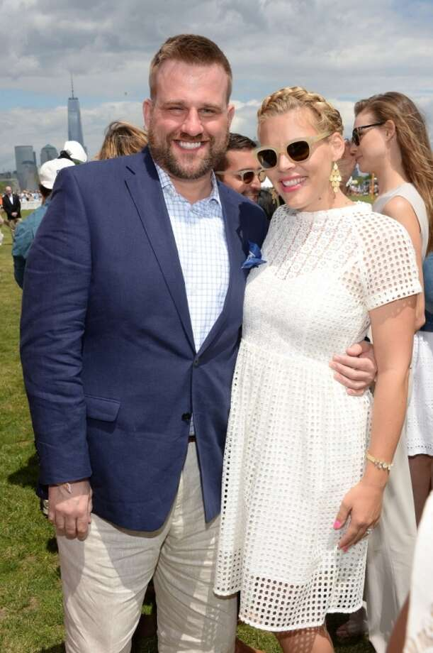 Stephen Wallen and Busy Philipps attend the seventh annual Veuve Clicquot Polo Classic in Liberty State Park on May 31, 2014 in Jersey City City. Photo: Dimitrios Kambouris, Getty Images For Veuve Clicquot