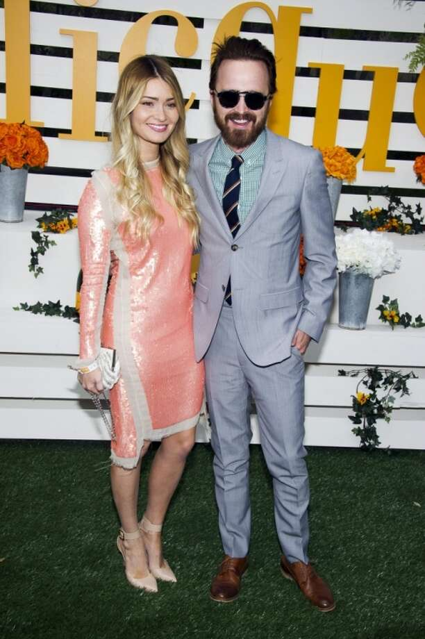 Lauren Parsekian, left, and Aaron Paul attend the Veuve Clicquot Polo Classic on Saturday, May 31, 2014, in Jersey City, N.J. Photo: Charles Sykes, Associated Press