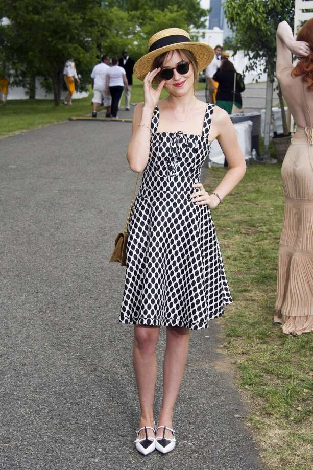 Dakota Johnson attends the Veuve Clicquot Polo Classic on Saturday, May 31, 2014, in Jersey City, N.J. Photo: Charles Sykes, Associated Press