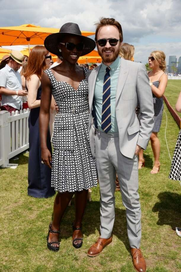 Lupita Nyong'o; Aaron Paul attend the seventh annual Veuve Clicquot Polo Classic in Liberty State Park on May 31, 2014 in Jersey City City. Photo: Dimitrios Kambouris, Getty Images For Veuve Clicquot