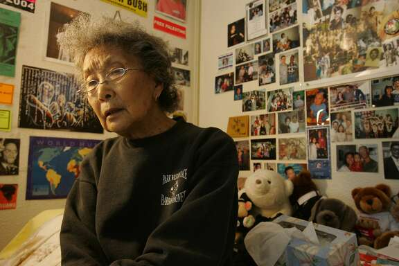 EBKOCHIYAMA__0026_PG.JPG   sitting on her bed covered with notes and corespondence,& political signs are all over her room, she speaks with much thought. Yuri Kochiyama, social and political activitist at her apt in a sr. living facility. San Francisco Chronicle, Penni Gladstone Photo taken on 8/23/05, in Oakland,   Ran on: 09-09-2005 Yuri Kochiyama's walls are plastered with photos, posters and correspondence of decades of radical liberation politics.  Ran on: 09-09-2005 Yuri Kochiyama has been one of the most prominent Asian American activists for more than 40 years.