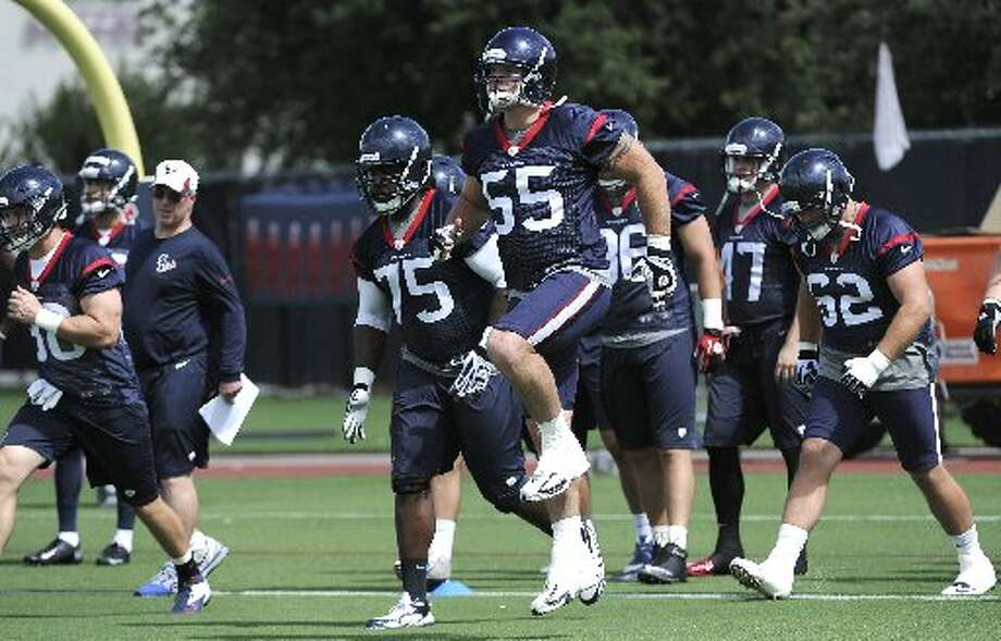 Texans center Chris Myers (55) is a step above the rest during a warm-up drill. Photo: Pat Sullivan, Associated Press