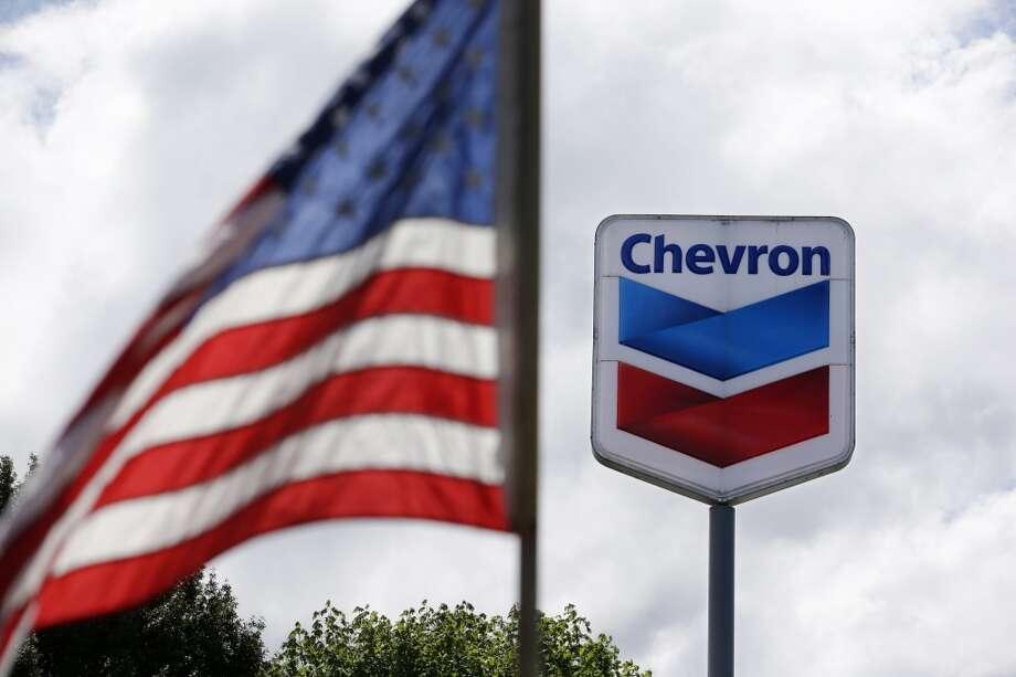 No. 3: Chevron  Previous Rank: 3 Headquarters: San Ramon, California  [Photo: A flag flies in view of a Chevron gas station.] Photo: Elaine Thompson, Associated Press