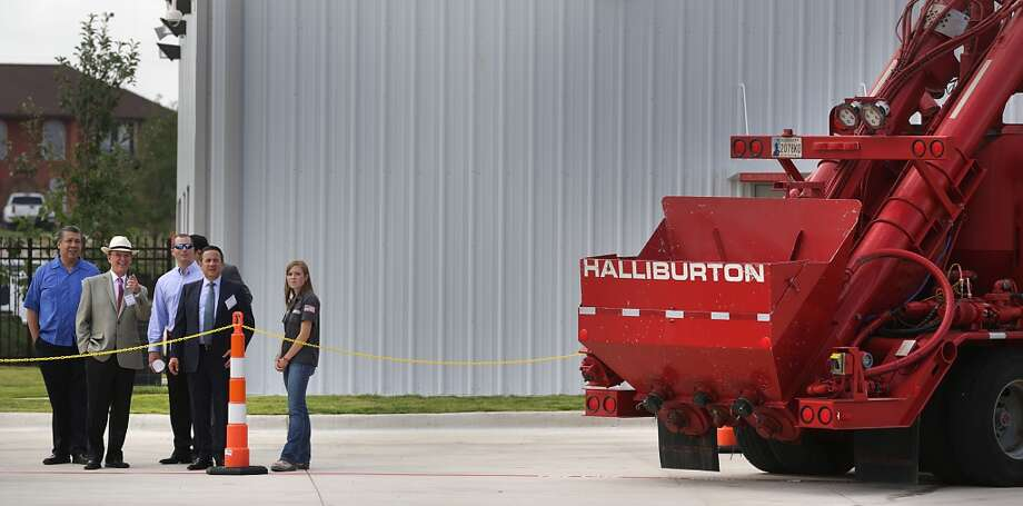 No. 103:  Halliburton Previous Rank: 106 Headquarters: Houston, Texas  [Photo: Bexar County Judge Nelson Wolff, in straw hat, and Texas State Senator Carlos Uresti, in dark suit, arrive at Halliburton's San Antonio Operations Center on Loop 1604 just west of I-37 on the south side, for their grand opening.] Photo: BOB OWEN, San Antonio Express-News