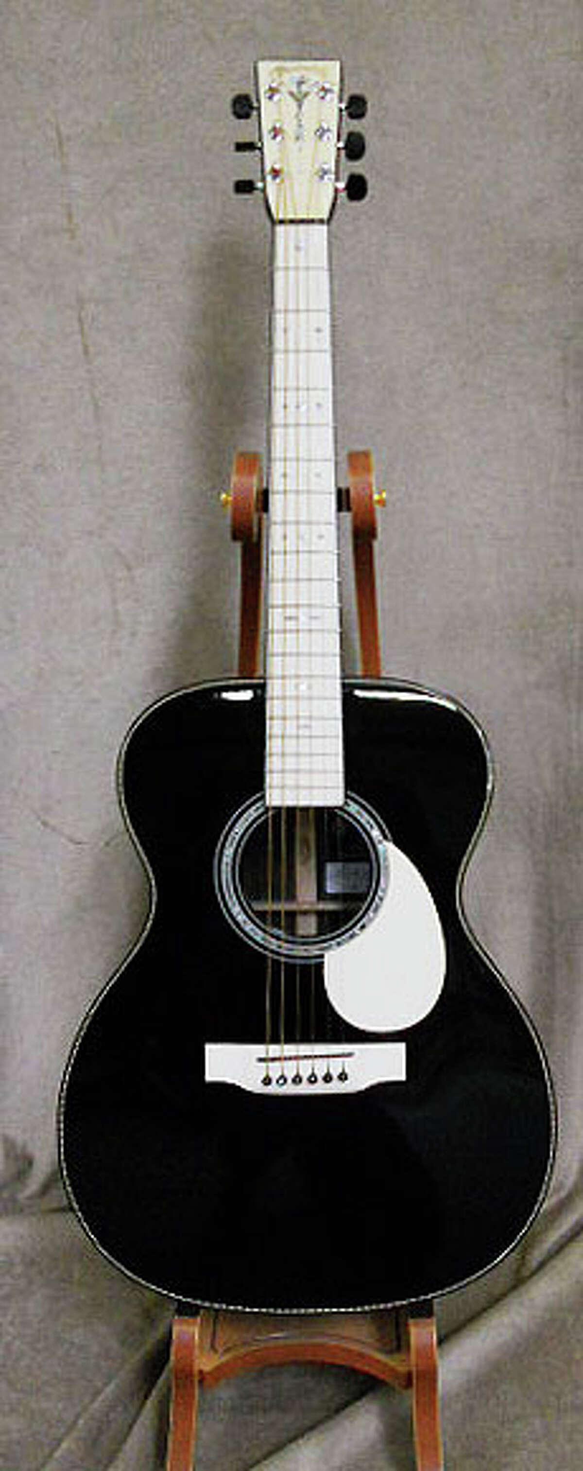 These guitars owned by the late Houston hand surgeon Michael Brown were sold at auction June 1, 2014 for a total of $100,000. The event, the latest in the continuing series of auctions from Brown's estate, included 36 guitars and one ukelele.