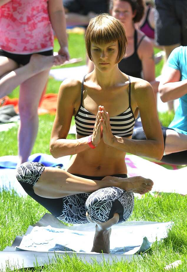 Praying Flamingo:Carrie Havranek holds a pose during a free outdoor Bikram yoga class on the front lawn of the 